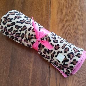 Leopard print reversible to fuchsia baby blanket